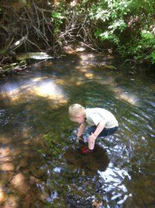 wading in creek spring break activities pic